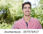 happy young casual man outdoor... | Shutterstock . vector #357576917