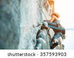 adult female rock climber on... | Shutterstock . vector #357593903