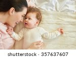 Stock photo happy family mother playing with her baby in the bedroom 357637607