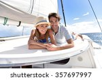 couple laying on a sailboat... | Shutterstock . vector #357697997