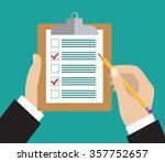 hand holding clipboard with... | Shutterstock . vector #357752657