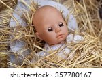 Head Doll And Straw In A Mange...