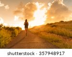 female running at sunset.  | Shutterstock . vector #357948917