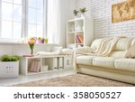 modern living room in bright... | Shutterstock . vector #358050527