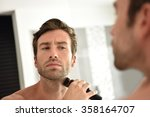 handsome man in bathroom... | Shutterstock . vector #358164707