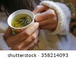 Stock photo the young woman on the couch and with sage tea on the hand 358214093