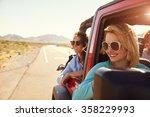 female friends on road trip in... | Shutterstock . vector #358229993