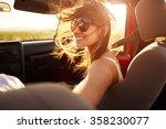 woman passenger on road trip in ... | Shutterstock . vector #358230077
