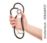 Hand Holding Stethoscope. All...