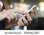 mobile phone in woman hand | Shutterstock . vector #358362287