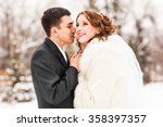bride and groom kissing in the... | Shutterstock . vector #358397357