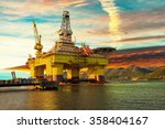 oil drilling rig in sunset time. | Shutterstock . vector #358404167