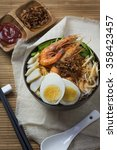Small photo of Malaysia Penang hawker food prawn mee noodle in bowl. Top view.