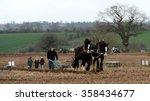 Small photo of WINGFIELD, UK - APR 4, 2015: Draught horses pull a plough through a field. Draught horses were traditionally used in ploughing before the large scale mechanisation of farming.