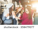 three women in a clothing store ... | Shutterstock . vector #358479077
