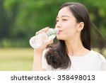 young attractive asian woman... | Shutterstock . vector #358498013