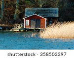 An Old Red  Wooden Boathouse...