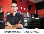 portrait of tattoo artist... | Shutterstock . vector #358724963