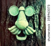 A Ornamental Face On A Tree.