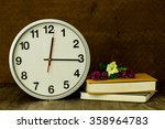 white clock on wooden table...