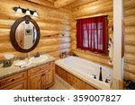 The Bath Room In A Rustic Log...