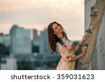 beautiful girl on the roof near ... | Shutterstock . vector #359031623