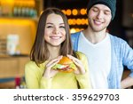 woman holding a burger. in the... | Shutterstock . vector #359629703