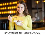 young beautiful girl eating ice ... | Shutterstock . vector #359629727