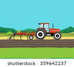 Tractor Plowing A Field For...