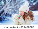 Little Girl Blows Snow With...
