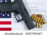 Small photo of Pistol, bullets, USA flag and Text of second amendment for the right to bear arms.