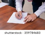 male hand with pen filling in... | Shutterstock . vector #359784683