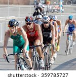 Small photo of STOCKHOLM, SWEDEN - AUG 23, 2015: Ryan Bailie and Andrea Salvisberg leading a group of male cycling triathlon competitors in the Men's ITU World Triathlon series event August 23, 2015,Stockholm,Sweden