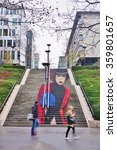Small photo of PARIS, FRANCE -15 DEC 2015- La Parisienne street art wall painting of a staircase in anamorphosis by muralists Zag and Sia on Rue du Chevaleret in the 13th arrondissement of Paris.