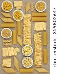 Small photo of Italian pasta sampler forming an abstract background over natural hemp paper background.