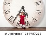 little girl with huge clock