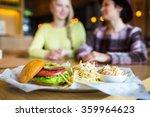 Two Girl   Eating Hamburger An...