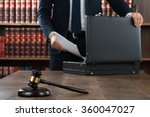Midsection Of Lawyer Putting...