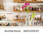 Flowers In Two Vases In A Whit...