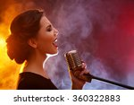 elegant woman singing in...