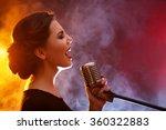 Elegant Woman Singing In...