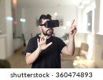 guy using vr glasses | Shutterstock . vector #360474893