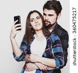 loving couple making selfie  | Shutterstock . vector #360475217
