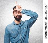 man making losser gesture   Shutterstock . vector #360550727
