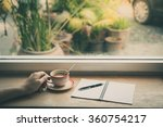 male hand holding coffee cup on ... | Shutterstock . vector #360754217