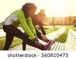 two girlfriends stretching in... | Shutterstock . vector #360810473