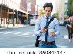 Businessman Using Smartphone...