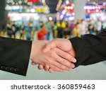 Small photo of Business handshake closing a deal with blur background of people in exhibition show