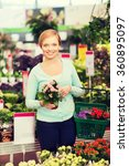 happy woman with shopping... | Shutterstock . vector #360895097