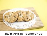 cookie on yellow background | Shutterstock . vector #360898463